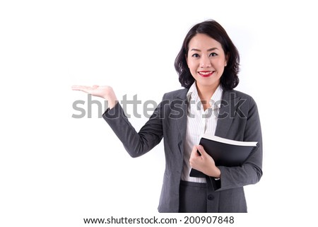 attractive business woman show something - stock photo