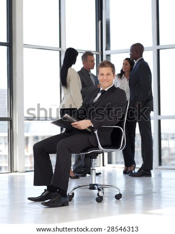 attractive businessman in office working - stock photo