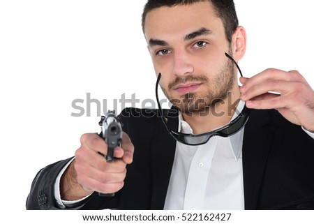 Attractive male with sun glasses holding gun in his hand. Assassin. Police officer. isolated on white