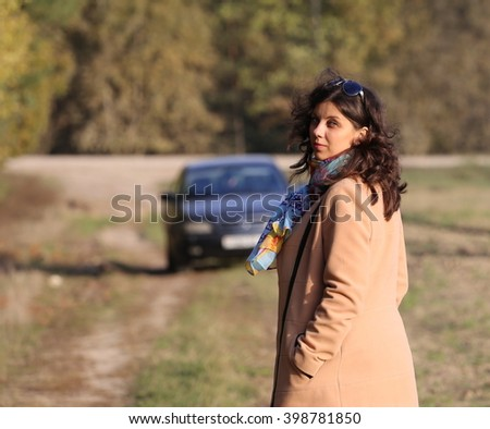 Attractive woman turned around, and goes to her car - stock photo