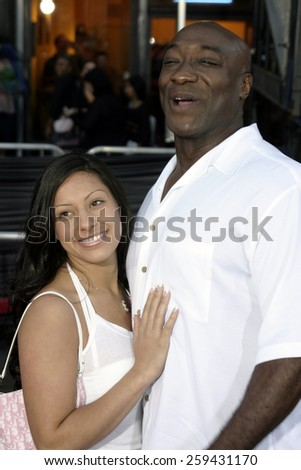 2 August 2004 - Los Angeles, California - Michael Clarke Duncan and guest. The World Premiere of 'Collateral' at the Orpheum Theatre in downtown Los Angeles.  - stock photo