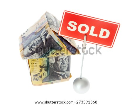 Australian Currency - money house with sold sign - stock photo