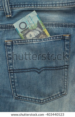 10 Australian dollar Banknote in back pocket of blue jeanse