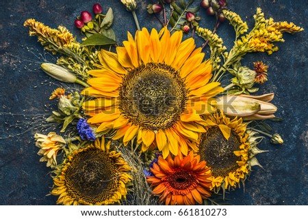 Autumn Flowers And Leaves Composition With Sunflowers On Dark Rustic Background Top View Fall