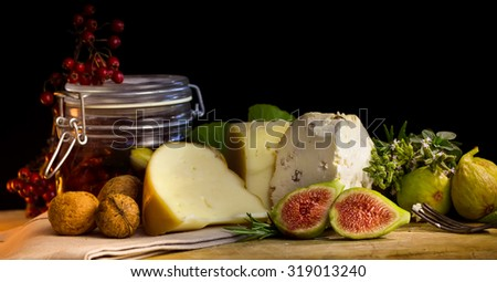 Autumn still life with walnut, cheese, fig and with spices.  - stock photo