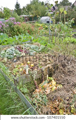 Autumnal compost bin in a vegetable garden