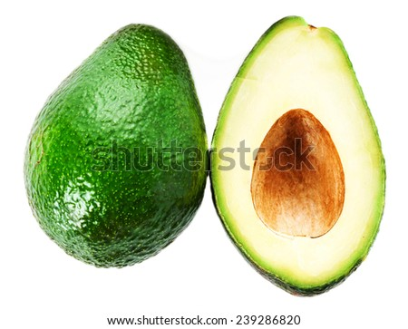 Avocado slice and whole ripe green avocado fruit isolated on a white background. Whole and half avocados macro  - stock photo