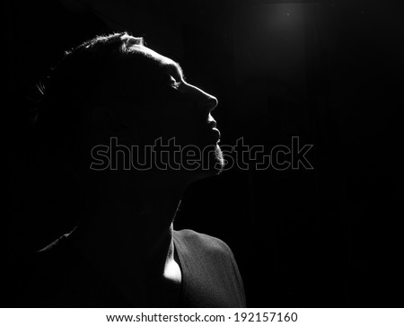 Awe. Male head profile silhouette. Dramatic theater performance - stock photo