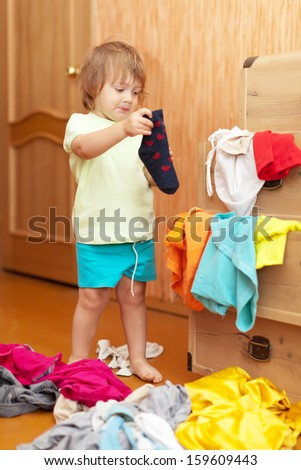 Baby girl  chooses dress in parent's closet