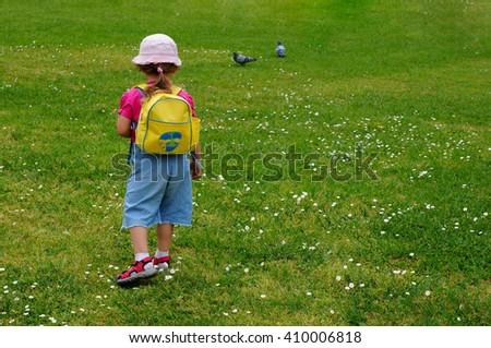 baby girl in the park                              - stock photo