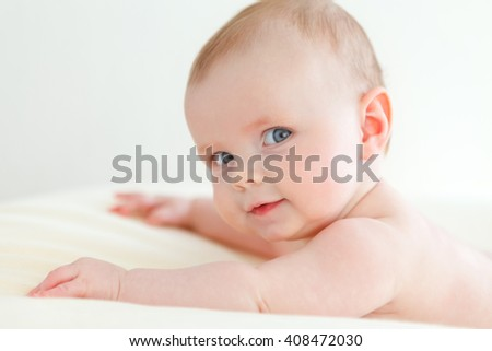 baby on a blanket smiling - stock photo