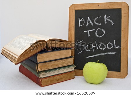 """Back to School"" blackboard, books, and apple"