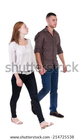 Back view going couple in jeans. walking friendly girl and guy holding hands. Rear view people collection. backside view of person. Isolated over white background.