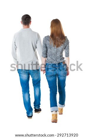 Back view going couple. walking friendly girl and guy holding hands. Rear view people collection. . Isolated over white background.  Man and woman holding hands going forward. leisurely strolling.