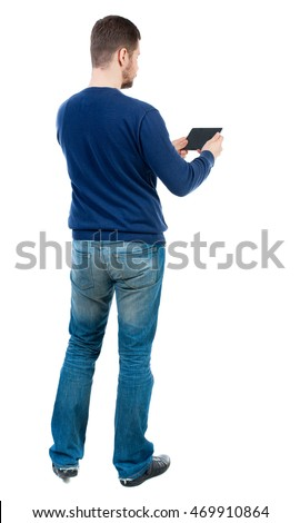 back view of business man uses mobile phone.    rear view people collection. Isolated over white background. backside view of person. bearded man in blue pullover horizontally holding the plate.