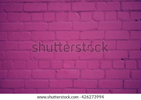 Background from Old Brick Wall Freshly Painted in Purple Color, with  Vignette - stock photo