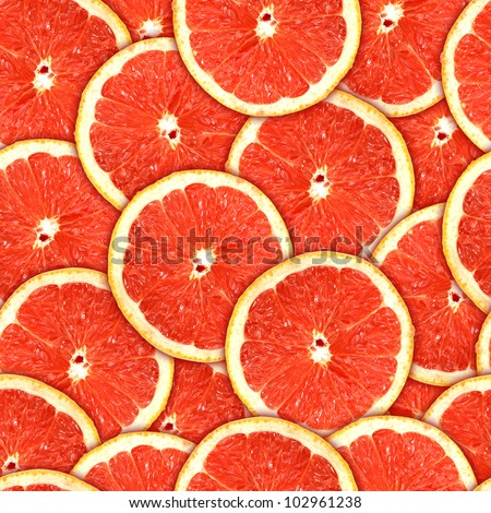 background of heap fresh red grapefruit slices. Seamless pattern for your design. Close-up. Studio photography. - stock photo