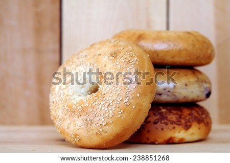 bagels on wooden table at market place  - stock photo