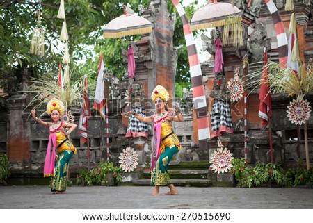 BALI, INDONESIA, DECEMBER, 24,2014: Two female  dancers in traditional Barong Dance show, Balinese performance on December 24, 2014 in Bali, Indonesia