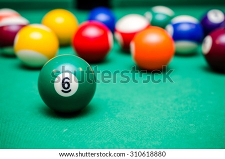 6 Ball from pool or billiards on a billiard table - stock photo