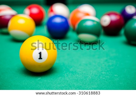 1 Ball from pool or billiards on a billiard table