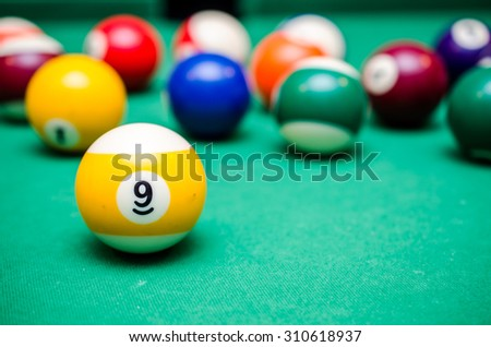 9 Ball from pool or billiards on a billiard table