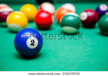 2 Ball from pool or billiards on a billiard table - stock photo