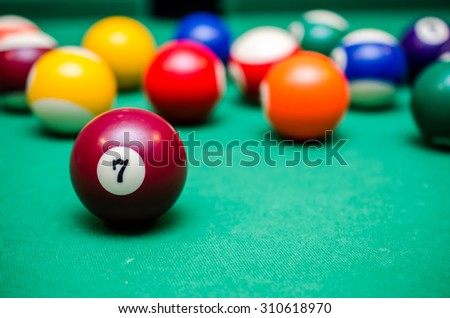 7 Ball from pool or billiards on a billiard table - stock photo