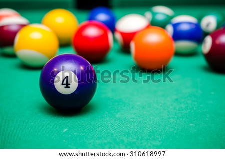4 Ball from pool or billiards on a billiard table
