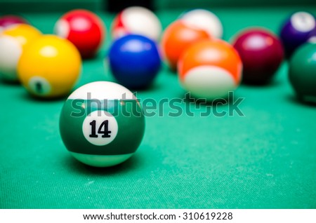 14 Ball from pool or billiards on a billiard table - stock photo