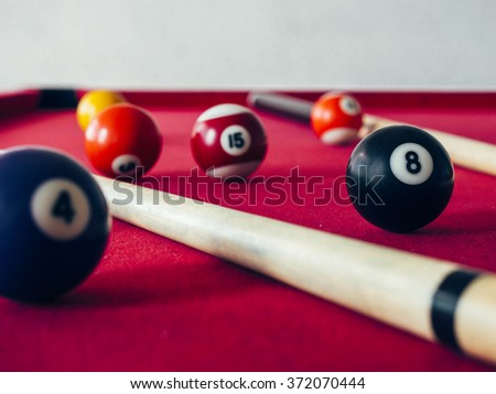 8 Ball from pool or billiards on a billiard table. Selective Focus.Billiard balls on the table.Vintage filtered style - stock photo