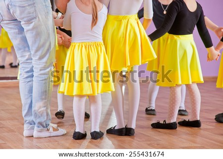 Ballet dancers children in class, legs only - stock photo