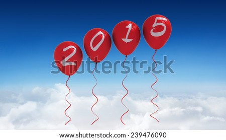 2015 balloons against blue sky over clouds