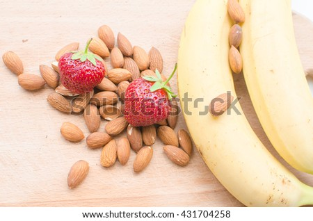 banana and strawberry. Ripe summer fruits . sliced ??banana and strawberries . Nuts .  healthy Eating - stock photo