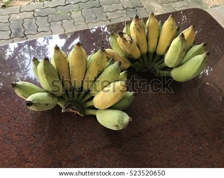 2 Banana on dark brown table