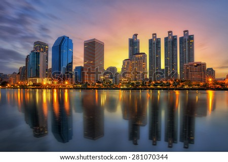 Bangkok city downtown at sunrise with reflection of skyline, Bangkok,Thailand