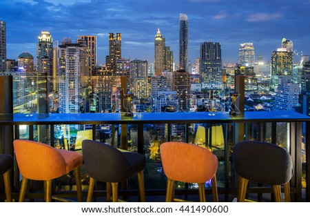 Bangkok city view point from rooftop of building, blue sky and city light, Thailand - stock photo