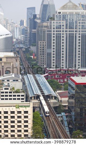 BANGKOK - March 30: Birds eye view of a BTS Skytrain on elevated rails in Ratchaprasong district on March 30, 2016 in Bangkok, Thailand.  - stock photo