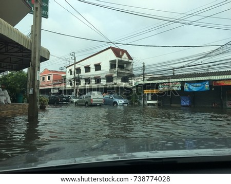 2017, Bangkok, Thailand, After the rainstorm has the flood in the street, traffic was difficult, traffic jams, anonymous people has chaotic of travel, was flooding the city.