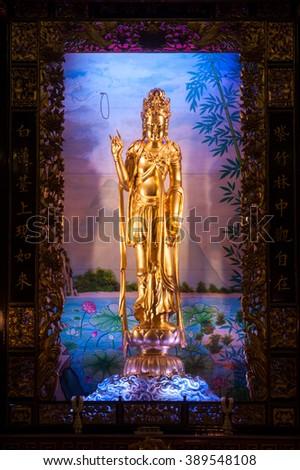 BANGKOK, THAILAND - FEBRUARY 1,2014 : Golden Kuan Yin Statue, the Goddess of Mercy inside of Thian Fah foundation shrine in Chinatown ,Yaowarat road of Bangkok,Thailand. - stock photo