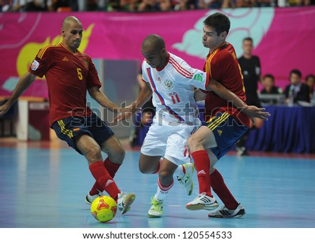 BANGKOK, THAILAND - NOV 14:Sirilo of Russia (w) in action during the FIFA Futsal World Cup Quarterfinal Round between Spain and Russia at Nimibutr Stadium on Nov14,2012 in Bangkok, Thailand.