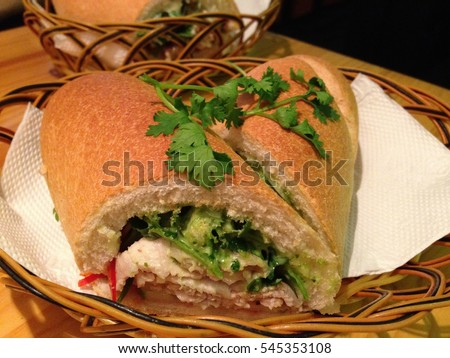 'Banh Mi', a famous traditional Vietnamese sandwich or bread with ham and vegetables inside. French style Vietnamese bread.