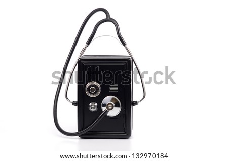 Bank steel safe and Stethoscope isolated, money saving risk concept - stock photo