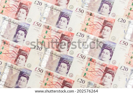 banknote 20 and 50 pound array in pattern - stock photo