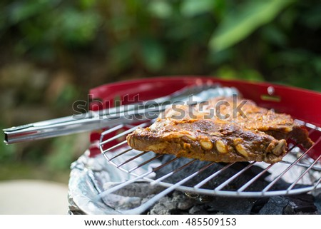 Barbecue grill pork meat cooking in the garden.