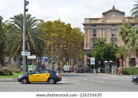 BARCELONA, SPAIN - SEPTEMBER 18: La Rambla in September 18, 2014 in Barcelona, Spain.Yellow and black taxi cabs in Barcelona - stock photo