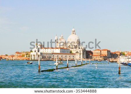 Basilica Santa Maria della Salute over  Grand canal water at sunny day, Venice, Italy