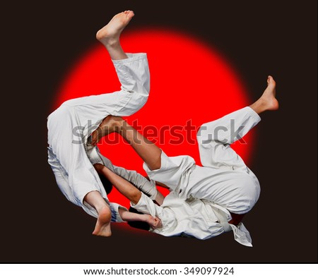 Battle throw karate.Sport.The image on a  background Japanese flag.