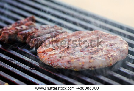 BBQ Grilled Burgers Patties On The Hot Charcoal Grill, shallow dof