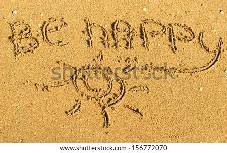 """""""Be Happy"""" written on the sand of beach - stock photo"""